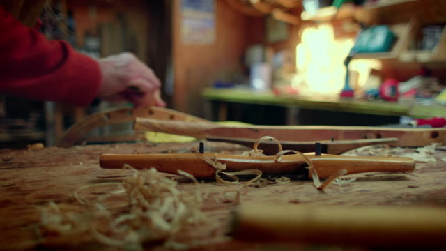 a piece of wood is rounded using workshop tools. - maglione video stock e b–roll