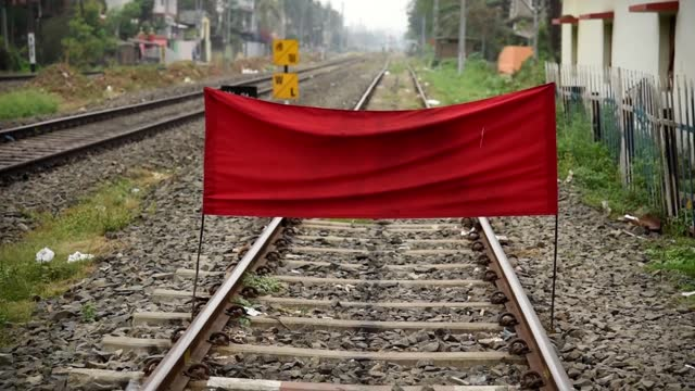 piece red cloth hanged on rail track to blocking movement of trains as workers on maintenance of railway tracks during nationwide lockdown due to... - railway track stock videos & royalty-free footage