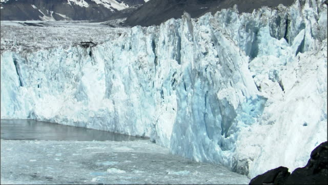 Pieces break off the Columbia Glacier and splash into the ocean. Available in HD.