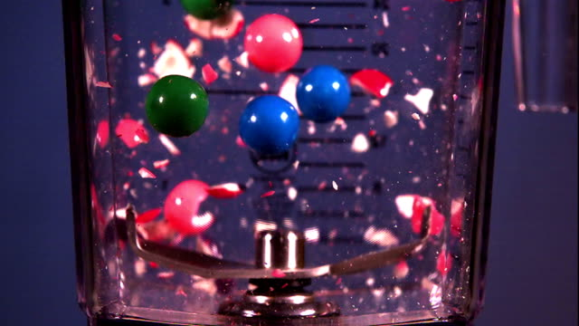 pieces of candy are shattered by a blender. - zerstörung stock-videos und b-roll-filmmaterial