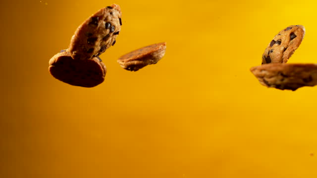 pieces of chocolate cookie rising in midair - food stock videos & royalty-free footage