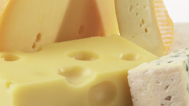 pieces of different cheeses on plate - cheese stock videos & royalty-free footage