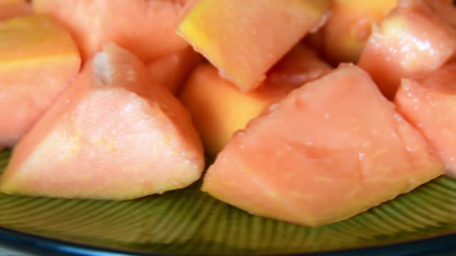 pieces of papaya fruit over a plate - papaya stock videos & royalty-free footage