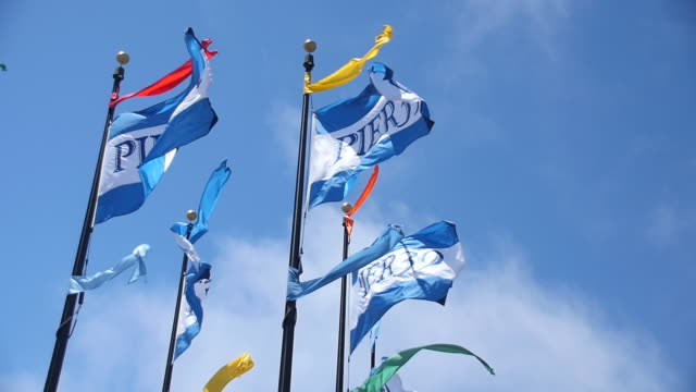 stockvideo's en b-roll-footage met 'pier 39' flags blowing in wind, slow motion, san francisco - pier 39