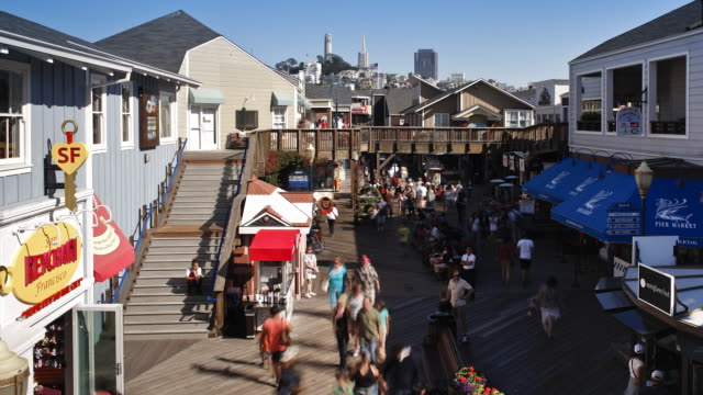 pier 39 looking towards telegraph hill, the coit tower and the business district, fisherman's wharf, san francisco, california time-lapse - pier 39 san francisco stock videos & royalty-free footage