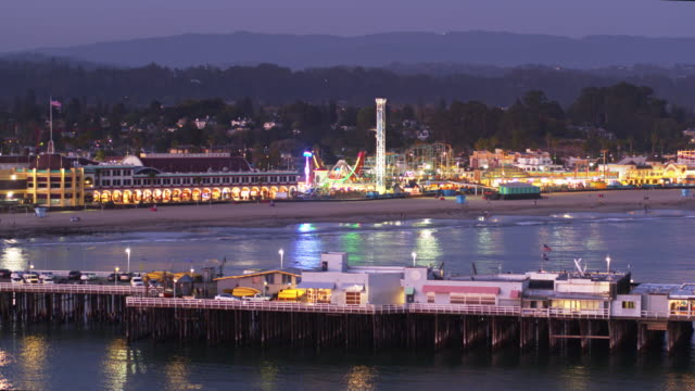 pier and boardwalk lit up at night in santa cruz, ca - drone shot - santa cruz california stock videos and b-roll footage