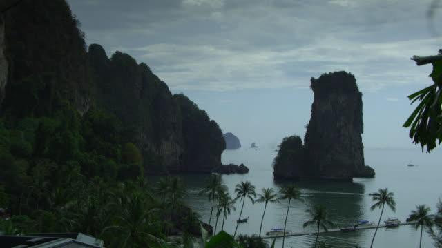 ws ha pier and cliffs on tropical beach, krabi, thailand - see other clips from this shoot 1459 stock videos and b-roll footage