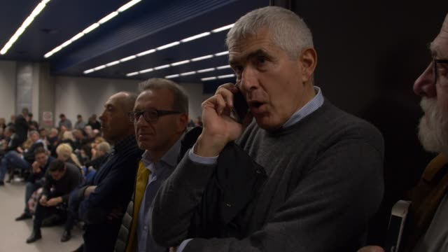 Pier Ferdinando Casini calling former PM Matteo Renzi on his mobile phone telling him to hurry March 2019 Renzi is running late while he was invited...