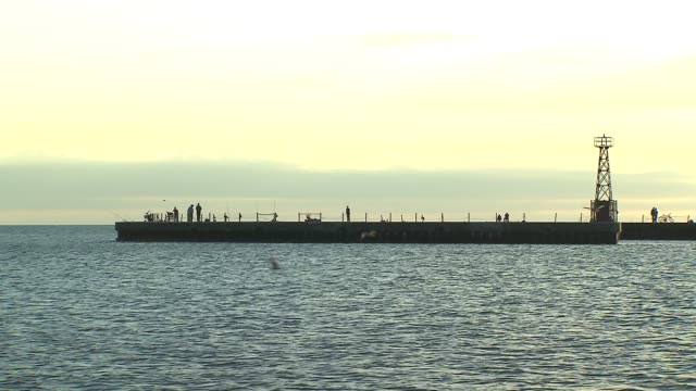 pier in lake michigan at montrose beach on july 23 2013 in chicago illinois - seeufer stock-videos und b-roll-filmmaterial