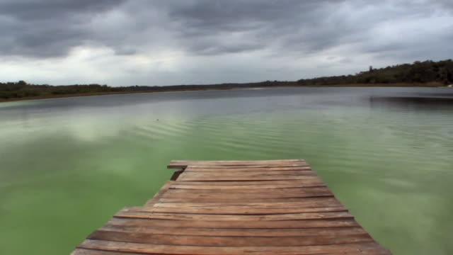 vídeos y material grabado en eventos de stock de ws pan pier on lake at punta laguna / tulum, quintana roo, mexico - quintana roo