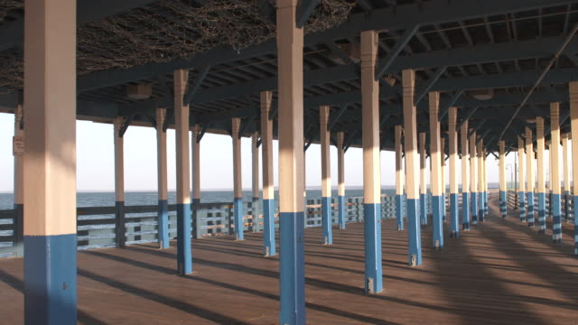 vídeos y material grabado en eventos de stock de pier pillars pan at sunset - vector