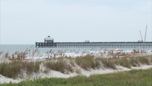 WS Pier stretching into ocean / Folly Beach, South Carolina, United States