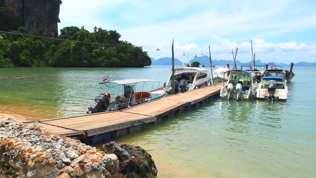 pier to tropical beach at kho yao noi, phang-nga, thailand. - bungalow stock videos and b-roll footage
