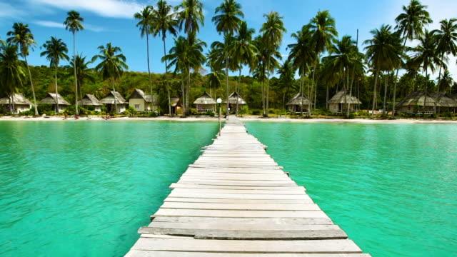 Pier to tropical beach