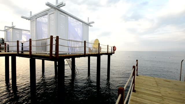 pier with tanning beds in the sea - ozgurdonmaz stock videos and b-roll footage