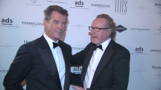 BROLL Pierce Brosnan Alistair Morrison at Lots Of Charity Event at St Pancras Renaissance Hotel on April 29 2015 in London England