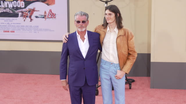 """pierce brosnan and dylan brosnan at the """"once upon a time in hollywood"""" premiere at tcl chinese theatre on july 22, 2019 in hollywood, california. - ピアース・ブロスナン点の映像素材/bロール"""