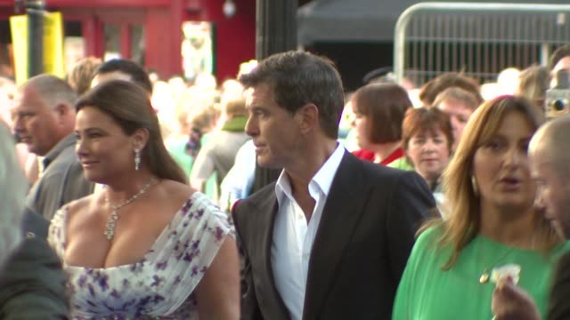 pierce brosnan and his wife keely shaye smith at the mamma mia premiere at london . - wife stock videos & royalty-free footage
