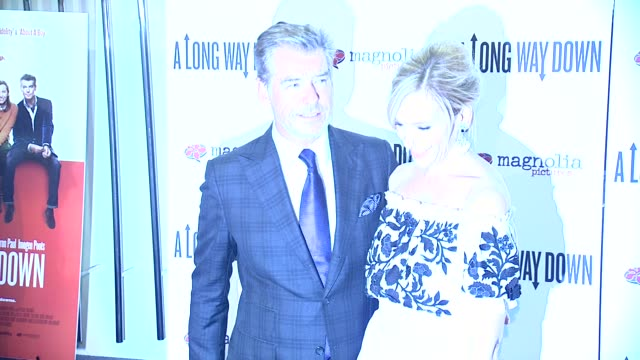 Pierce Brosnan and Toni Collette at A Long Way Down New York Premiere at City Cinemas 123 on June 30 2014 in New York City