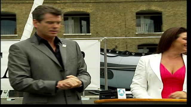 pierce brosnan at launch of whale research ship itn london st katherine's dock ext actor pierce brosnan and wife keely shaye smith launching... - keely shaye smith and pierce brosnan stock videos & royalty-free footage