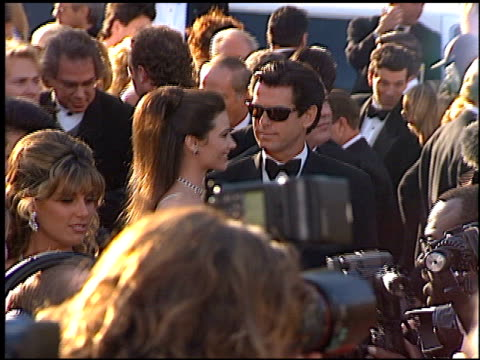 pierce brosnan at the 1996 academy awards arrivals at the shrine auditorium in los angeles, california on march 25, 1996. - 第68回アカデミー賞点の映像素材/bロール
