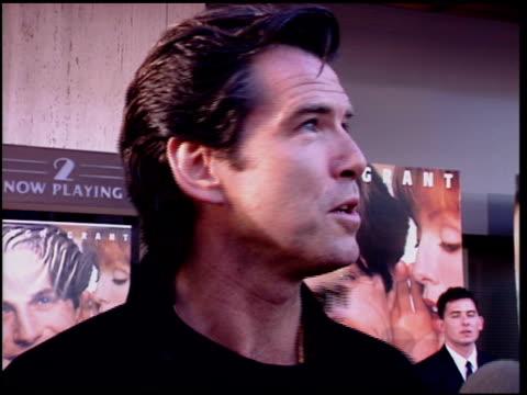pierce brosnan at the 'nine months' premiere on july 11, 1995. - ピアース・ブロスナン点の映像素材/bロール