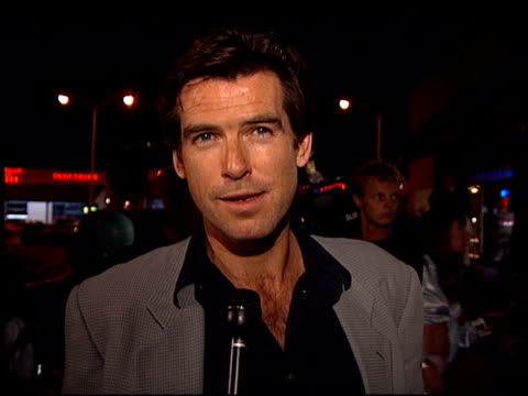 pierce brosnan at the save the dolphins event at atlantis clothing cafe in malibu, california on october 26, 1995. - ピアース・ブロスナン点の映像素材/bロール