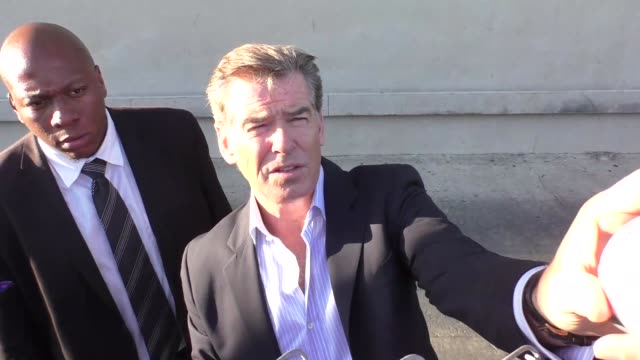 pierce brosnan greets fans at jimmy kimmel live in hollywood celebrity sightings on aug 27 2015 in los angeles california - pierce brosnan stock videos and b-roll footage