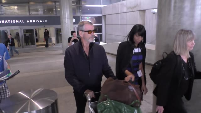 pierce brosnan greets fans at lax airport in los angeles at celebrity sightings in los angeles on january 18 2016 in los angeles california - pierce brosnan stock videos and b-roll footage