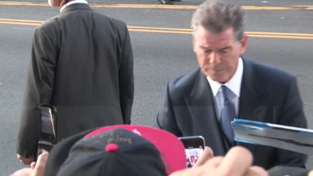 pierce brosnan greets fans at the november man premiere in hollywood in celebrity sightings in los angeles - pierce brosnan stock videos and b-roll footage