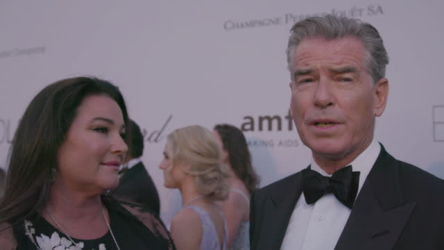 interview pierce brosnan keely shaye smith on being at amfar at amfar gala cannes 2018 at hotel du capedenroc on may 17 2018 in cap d'antibes france - keely shaye smith and pierce brosnan stock videos & royalty-free footage