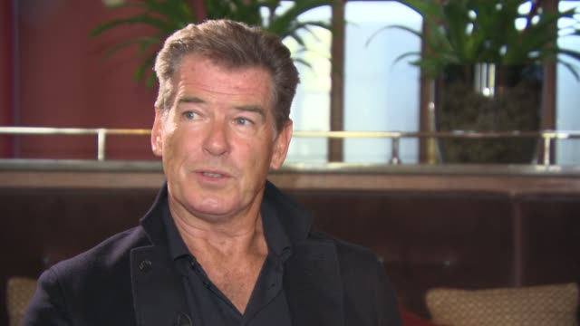 pierce brosnan on 'the expendables', not being apart of it now or in the future, if the money was right, respecting the cast of 'the expendables' at... - ピアース・ブロスナン点の映像素材/bロール