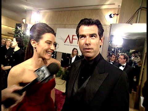 pierce brosnan talks about clint eastwood - keely shaye smith and pierce brosnan stock videos & royalty-free footage