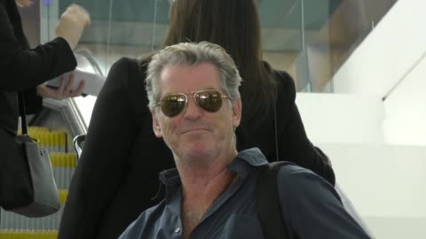 pierce brosnan & wife keely shaye smith departing at lax airport in los angeles in celebrity sightings in los angeles, - wife stock videos & royalty-free footage