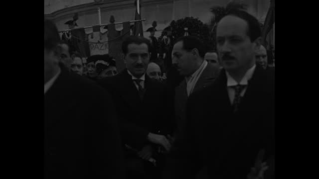 MS Pierre Laval French Foreign Minister turns to camera and walks past camera with hat in hand / MWS Laval with other officials walking toward camera...