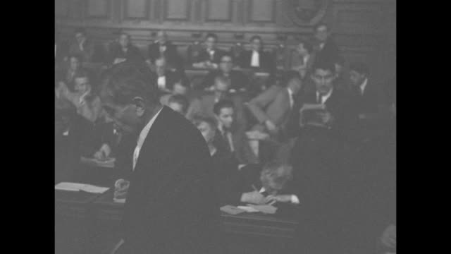 vs pierre laval speaks to court / president of the court pierre mongibeaux takes off his hat and speaks / ws court from gallery judges at long table... - anwalt stock-videos und b-roll-filmmaterial