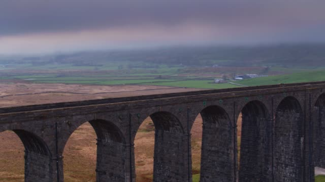 piers and arches of ribblehead viaduct - drone shot - yorkshire video stock e b–roll