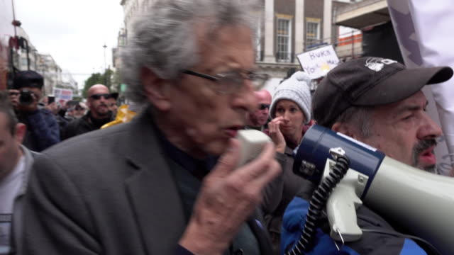 piers corbyn uses a megaphone to show support for liverpool while leading a protest promoting coronavirus and qanon conspiracy theories on october... - marching stock videos & royalty-free footage