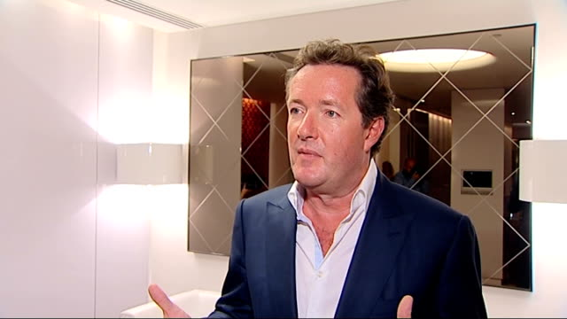piers morgan at launch of burger king 'flame' cologne: photocall / interview; piers morgan interview sot - on 'flame' fragrance / real man's scent... - スーザン ボイル点の映像素材/bロール