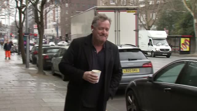 piers morgan doorstep interview; england: london: edwardes square: ext piers morgan along with takeaway drink / morgan returning to his house / - news not politics video stock e b–roll