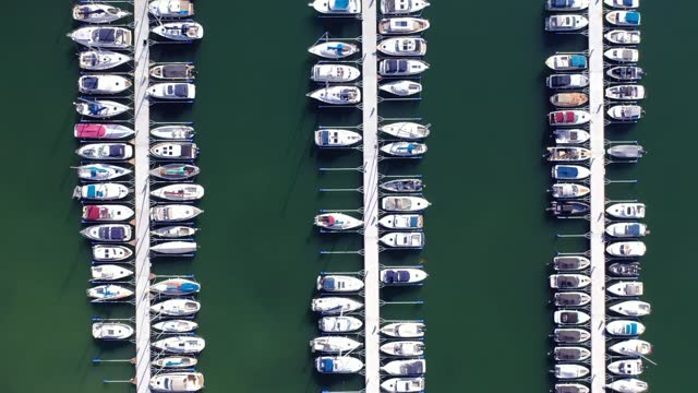 piers with boats at a marina viewed from above - marina stock videos & royalty-free footage
