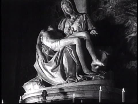pieta marble sculpture by michelangelo. jesus, mary, madonna, crucifixion, roman catholic, christian, damaged, repaired, icon, iconic. - ミケランジェロ点の映像素材/bロール