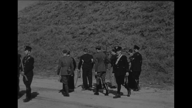 vs pietro caruso with crutches steps from closed van and is escorted on a dirt road to a waiting chair and given the last rites prior to his... - hinrichtung stock-videos und b-roll-filmmaterial