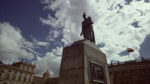 la ws pigeon perching atop statue of simon bolivar in plaza bolivar / bogota, colombia - colombian flag stock videos and b-roll footage