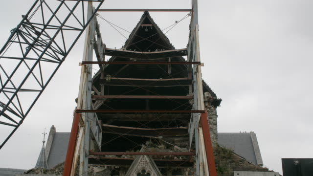 Pigeons roost in the exposed frontage of the Christchurch Cathedral