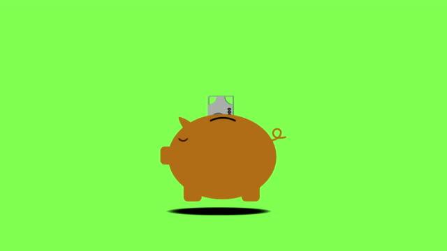 vidéos et rushes de piggy bank.money entrer à l'intérieur de la tirelire avec l'écran vert de fond de canal alpha - tirelire