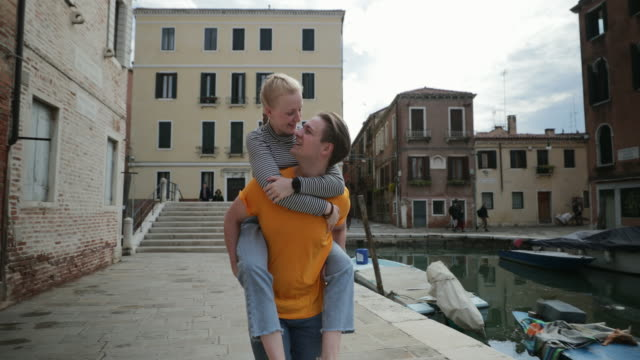 piggyback in venice - italian culture stock videos & royalty-free footage