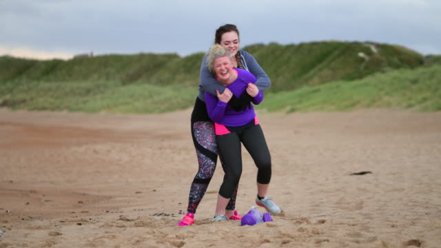piggy-back racing on the beach - body positive stock videos & royalty-free footage