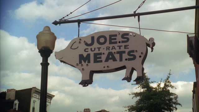 ws la pig-shaped sign for store selling meat - butcher stock videos & royalty-free footage