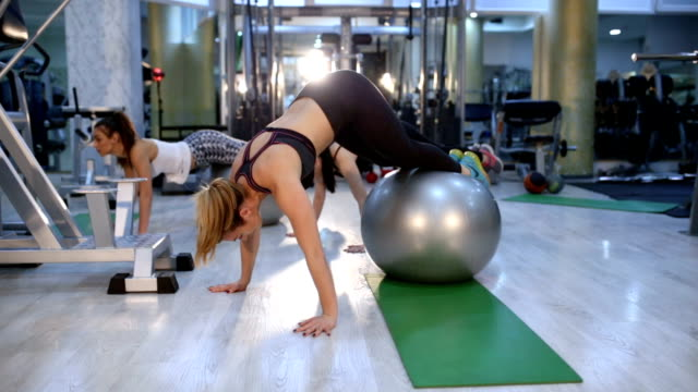 pilates ball work out - sports training drill stock videos & royalty-free footage